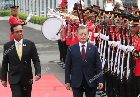 South Korean President Moon Jae-in (R) and Thailand's Prime Minister Prayuth Chan-ocha (L) review an honor guard during a welcoming ceremony at the Government House of Thailand in Bangkok, Thailand, 02 September 2019.