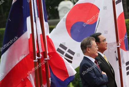 South Korean President Moon Jae-in (L) and Thailand's Prime Minister Prayuth Chan-ocha (R) listen to their national anthems during a welcoming ceremony at the Government House of Thailand in Bangkok, Thailand, 02 September 2019.