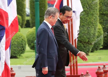 South Korean President Moon Jae-in (L) is shown the way by Thailand's Prime Minister Prayuth Chan-ocha (R) during a welcoming ceremony at the Government House of Thailand in Bangkok, Thailand, 02 September 2019.