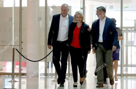 From left, Dietmar Woidke, top candidate of Brandenburg's Social Democratic Party (SPD), Manuela Schwesig, acting co-chairwomen of the German Social Democratic Party (SPD) and Martin Dulig, top candidate of Saxony's Social Democratic Party (SPD) arrive for a press conference in Berlin, Germany, one day after the federal state elections in the German states of Saxony and Brandenburg