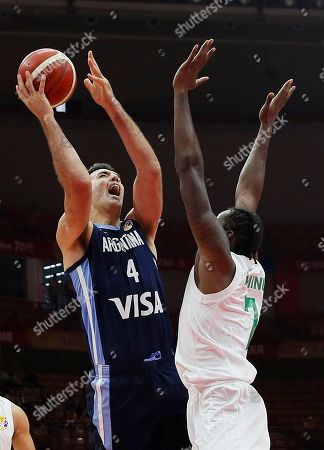 Stock Photo of Luis Scola (L) of Argentina in action against Al Farouq Aminu of Nigeria during the FIBA Basketball World Cup 2019 match between Nigeria and Argentina in Wuhan, China, 02 September 2019.