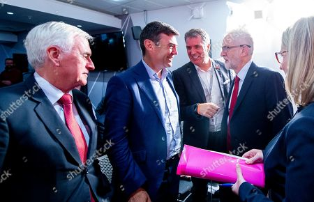 Jeremy Corbyn, Leader of the Labour Party (R), is joined by John McDonnell Shadow Chancellor of the Exchequer (L), Andy Burnham (C-L) and Steve Rotherham (C-R) after making a keynote speech on the day before Parliament returns, Manchester, Britain, 02 September 2019.