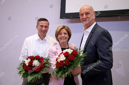 (L-R) Saxony chairman and top candidate of the Social Democratic Party (SPD) Martin Dulig, Premier of Rhineland-Palatinate Malu Dreyer and Brandenburg Premier and chairman of the Social Democratic Party (SPD) Dietmar Woidke pose with flower bouquets prior to the start of the SPD board meeting in Berlin, Germany, 02 September 2019. One day after regional elections in the federal states of Brandenburg and Saxony the boards of federal German parties meet to discuss the outcome.