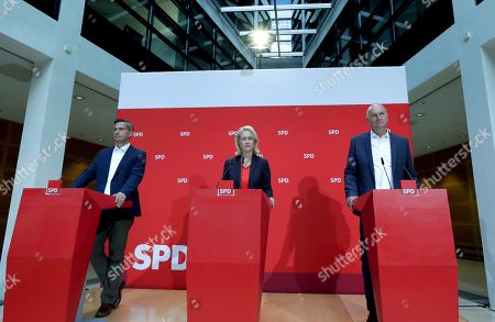 Stock Photo of From right, Dietmar Woidke, top candidate of Brandenburg's Social Democratic Party (SPD), Manuela Schwesig, acting co-chairwomen of the German Social Democratic Party (SPD) and Martin Dulig, top candidate of Saxony's Social Democratic Party (SPD address the media during a press conference in Berlin, Germany, one day after the federal state elections in the German states of Saxony and Brandenburg
