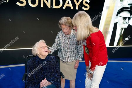 """Stock Picture of Virginia McCaskey looks up towards Patricia Rooney, center, and Norma Hunt at the premiere of """"A Lifetime of Sundays,"""" in Phoenix, . Four female NFL team owners were reticent about the project when approached by Jane Skinner Goodell, the commissioner's wife and an executive producer of the movie. Indeed, she received a polite no from each of the women, who range in age from 81 to 96"""