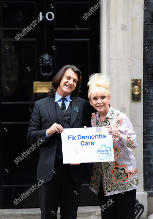Dame Barbara Windsor and husband Scott Mitchell deliver a letter from the Alzheimer's Society to the Prime Minister at 10 Downing street to call for improvements in dementia care.