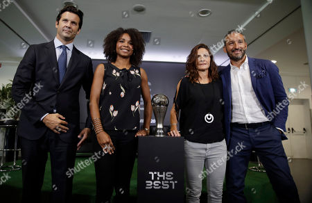 From left, former players Santiago Solari, Laura Georges, Patrizia Panico and Gianluca Zambrotta pose during a press conference to present the FIFA best player award, at the San Siro stadium in Milan, Italy, . Five-time winners Cristiano Ronaldo and Lionel Messi, and Virgil van Dijk are the three finalists for the FIFA best player award. United States forward Megan Rapinoe is the favorite for the women's award. The ceremony will be held at the La Scala theatre in Milan on Sep.23