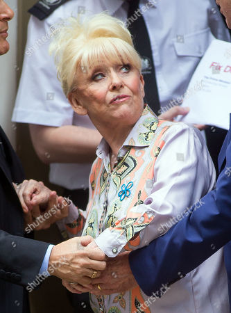 Dame Barbara Windsor delivers a letter from the Alzheimer's Society to the Prime Minister at 10 Downing street to call for improvements in dementia care.