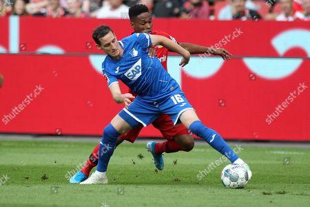 Sebastian Rudy of TSG 1899 Hoffenheim (L) and Wendell of Leverkusen are seen in action