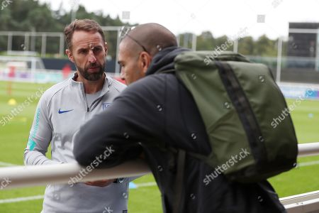 Stock Picture of England manager Gareth Southgate talks to Stan Collymore during the session