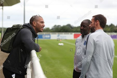 England manager Gareth Southgate talks to Stan Collymore and Chris Powell during the session