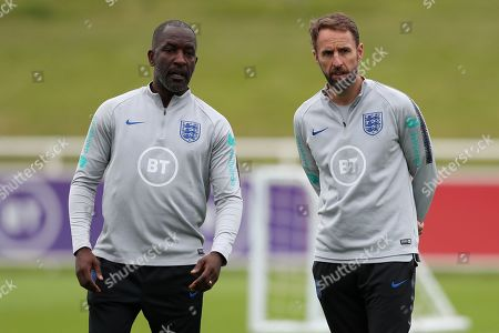 England manager Gareth Southgate talks to Chris Powell during the training session