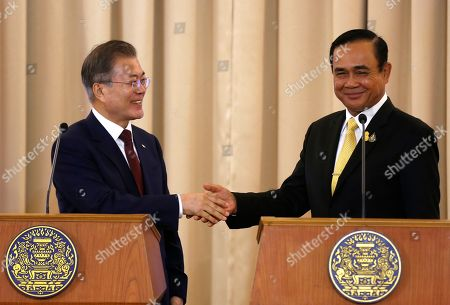 South Korean President Moon Jae-in shaking hands with Thailand's Prime Minister Prayuth Chan-ocha during a press conference at Government House in Bangkok during his official visit in the country.