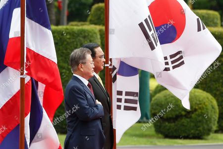 South Korean President Moon Jae-in and Thailand's Prime Minister Prayuth Chan-ocha review the guard of honour during a welcoming ceremony at the Government House in Bangkok.