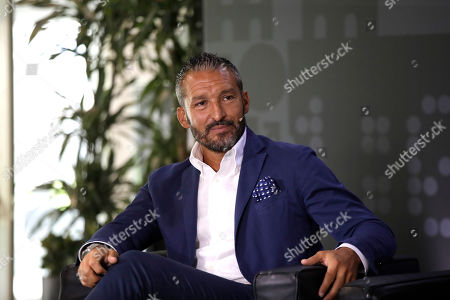 Former soccer player Gianluca Zambrotta attends a press conference to present the FIFA best player award, at the San Siro stadium in Milan, Italy, . Five-time winners Cristiano Ronaldo and Lionel Messi, and Virgil van Dijk are the three finalists for the FIFA best player award. United States forward Megan Rapinoe is the favorite for the women's award. The ceremony will be held at the La Scala theatre in Milan on Sep.23