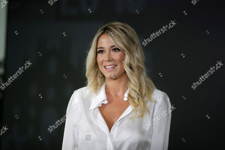 Stock Picture of Italian TV host Diletta Leotta speaks during a press conference to present the FIFA best player award, at the San Siro stadium in Milan, Italy, . Five-time winners Cristiano Ronaldo and Lionel Messi, and Virgil van Dijk are the three finalists for the FIFA best player award. United States forward Megan Rapinoe is the favorite for the women's award. The ceremony will be held at the La Scala theatre in Milan on Sep.23