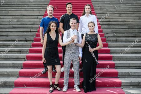 Stock Photo of (front-L-R) Violinist Midori Seiler, Harp player Konstantin Reinfeld, clarinetist Friederike Roth and (back-L-R) flutist Emmanuel Pahud, clarinetist Andreas Ottensamer and tenor Benedikt Kristjansson pose for a group photo during the presentation of the winners of the 'Opus Klassik' award at the Konzerthaus music hall in Berlin, Germany, 02 September 2019. The award ceremony of the 'Opus Klassik' award will be held 13 October 2019 at the Berlin Konzerthaus music hall.