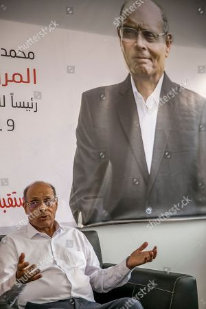 Former Tunisian President and head of el-Harak party Moncef Marzouki speaks with the Associated Pressin Tunis, Wednesday Aug.28, 2019. Tunisia's 26 presidential candidates have launched their campaigns in a political climate marked by uncertainty, money laundering allegations and worries about violent extremism