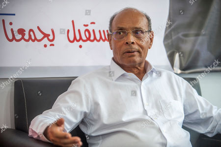 Stock Photo of Former Tunisian President and head of el-Harak party Moncef Marzouki speaks with the Associated Pressin Tunis, Wednesday Aug.28, 2019. Tunisia's 26 presidential candidates have launched their campaigns in a political climate marked by uncertainty, money laundering allegations and worries about violent extremism