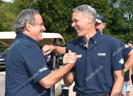 Former French soccer legend and UEFA president Michel Platini (L) greets former Dutch international Marco Van Basten (R) during the 16th edition of the 'Vialli and Mauro Golf Cup' charity golf tournament at the Royal Park i Roveri course in Turin, 02 September 2019.