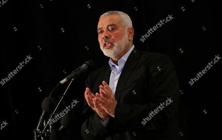 Head of the Political Bureau of Hamas Ismail Haniyeh speaks during a memorial service for the three Palestinian policemen, in Gaza city