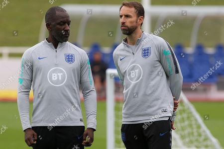 England coach Chris Powell with England head coach Gareth Southgate during the England training session at St George's Park National Football Centre, Burton-Upon-Trent