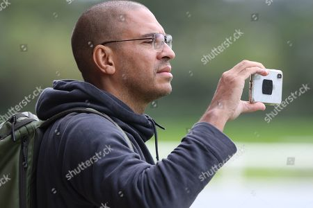 Former England player Stan Collymore watches on during the England training session at St George's Park National Football Centre, Burton-Upon-Trent