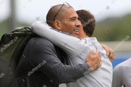 Stock Photo of Former England player Stan Collymore and England head coach Gareth Southgate hug during the England training session at St George's Park National Football Centre, Burton-Upon-Trent