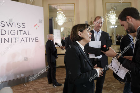 Swiss President Ueli Maurer (L) and Former Swiss president Doris Leuthard (R), President of the board of the foundation Swiss Digital Initiative, speak to reporters following a press conference after the kick-off of Swiss Digital Initiative, in Geneva, Switzerland, 02 September 2019.
