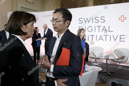 Stock Image of Former Swiss president Doris Leuthard (L), President of the board of the foundation Swiss Digital Initiative, speaks with Eric Xu (R), Deputy Chairman of Huawaei, prior to a press conference after the kick-off of Swiss Digital Initiative, in Geneva, Switzerland, 02 September 2019.