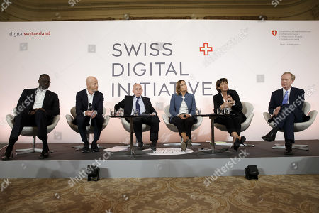 Stock Picture of Former Swiss President Doris Leuthard (2-R), president of the board of the foundation Swiss Digital Initiative, sitting next to Tidjane Thiam (L) CEO of Credit Suisse, Marc Walder (2-L) CEO of Ringier, Swiss President Ueli Maurer (3-L), Gillians Tans (3-R), Chairwoman of Booking.com, and Brad Smith (R) CEO of Microsoft, speaks to the media after the kick-off of Swiss Digital Initiative, during a press conference, in Geneva, Switzerland, 02 September 2019.