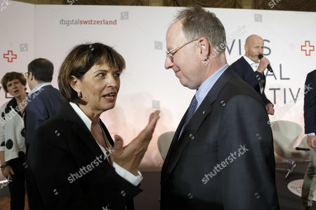 Former Swiss president Doris Leuthard (L), President of the board of the foundation Swiss Digital Initiative, speaks with Andre Kudelski (R), Chairman of the Board and CEO of the Kudelski Group, prior to a group picture, after the kick-off of Swiss Digital Initiative, in Geneva, Switzerland, 02 September 2019.