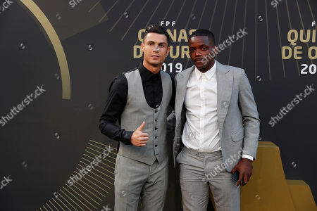 Juventus' Cristiano Ronaldo, left thumbs up flanked by Betis player William Carvalho as they arrive for the Portuguese soccer federation awards ceremony in Lisbon