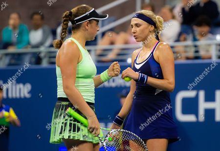 Jelena Ostapenko of Latvia and Lyudmyla Kichenok of the Ukraine playing doubles