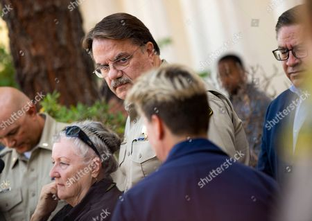 Stock Image of Bill Brown, Monica Rochester. Santa Barbara County Sheriff Bill Brown, middle, watches as Coast Guard Capt. Monica Rochester, right, approaches the podium outside of the Santa Barbara County Sheriff's headquarters for a news conference in Santa Barbara, Calif., . A fire raged through a boat carrying recreational scuba divers anchored near an island off the Southern California coast early Monday, leaving multiple people dead and hope diminishing that any of the more than two dozen people still missing would be found alive