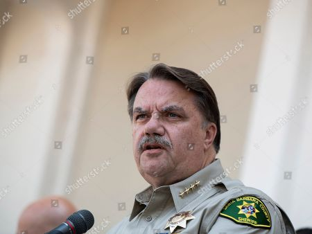 Stock Photo of Santa Barbara County Sheriff Bill Brown, addresses the media outside the Santa Barbara County Sheriffs headquarters in Santa Barbara, Calif., . A fire raged through a boat carrying recreational scuba divers anchored near an island off the Southern California coast early Monday, leaving multiple people dead and hope diminishing that any of the more than two dozen people still missing would be found alive