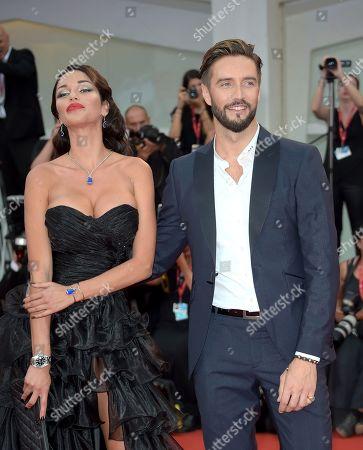 Delia Duran and Alex Belli