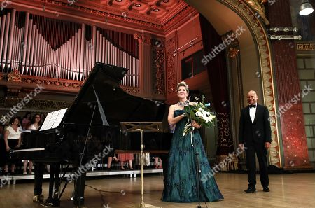 US operatic lyric-coloratura mezzo-soprano, Joyce DiDonato (L), and French collaborative pianist and opera accompanist David Zobel (R), greet the audience after performing a recital on the stage of the Romanian Athenaeum concert hall during the George Enescu International Festival 2019, in Bucharest, Romania, 02 September 2019. The festival, held since 1958 every two years, is the biggest classical music festival held in Romania, in honor of Romanian composer and violinist George Enescu. The 24th edition of the George Enescu International Festival takes place between 31 August and 22 September 2019.