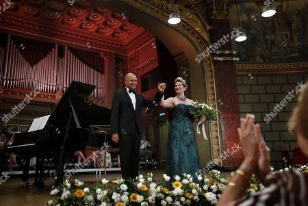 US operatic lyric-coloratura mezzo-soprano, Joyce DiDonato (R), and French collaborative pianist and opera accompanist David Zobel (L), greet the audience after performing a recital on the stage of the Romanian Athenaeum concert hall during the George Enescu International Festival 2019, in Bucharest, Romania, 02 September 2019. The festival, held since 1958 every two years, is the biggest classical music festival held in Romania, in honor of Romanian composer and violinist George Enescu. The 24th edition of the George Enescu International Festival takes place between 31 August and 22 September 2019.