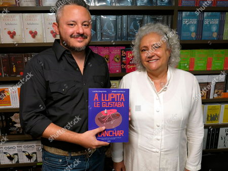 """Stock Image of Mexican author Laura Esquivel, right, and the Mexican illustrator Jordi Castells pose for a portrait during an interview in Mexico City. Esquivel and Castells present """"A Lupita le gustaba planchar"""" a graphic version of the namesake novel by Esquivel"""