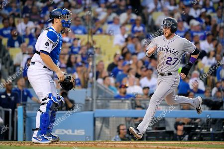 Trevor Story, Will Smith. Colorado Rockies' Trevor Story, right, scores on a double by Daniel Murphy as Los Angeles Dodgers catcher Will Smith stands at the plate during the fifth inning of a baseball game, in Los Angeles