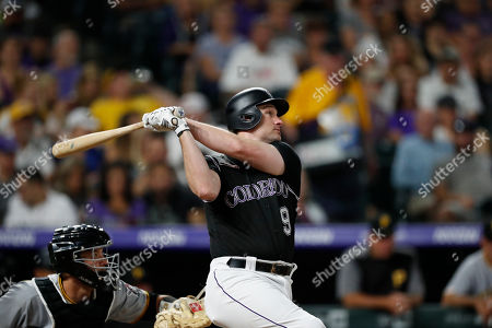 R m. Colorado Rockies first baseman Daniel Murphy (9) in the fifth inning of a baseball game, in Denver