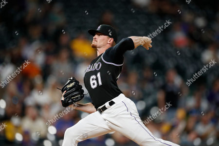 R m. Colorado Rockies relief pitcher Sam Howard (61) in the ninth inning of a baseball game, in Denver. Pittsburgh won 11-4