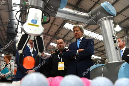 Former US Secretary Of State John F. Kerry (R) tours the Innovation Precinct at the Global Table conference at the Melbourne Showgrounds in Melbourne, Australia, 03 September 2019. Key leaders in food, agricultural science, technology and medicine are in Melbourne for a three-day global conference addressing questions around sustaining a growing population, the climate crisis and unsustainable levels of development.