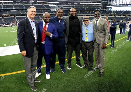 Danny White, Emmitt Smith, Nate Newton, Marcus Spears, Brad Sham, Michael Irvin. Former Dallas Cowboys players Danny White, from left, Emmitt Smith, Nate Newton, Marcus Spears, radio announcer Brad Sham and former wide receiver Michael Irvin, right, pose for a photo before a preseason NFL football game against the Tampa Bay Buccaneers in Arlington, Texas