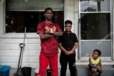 """Joshua K. Love stands with his son, Joshua K. Love Jr., center, and his nephew, Mason Martinez, on the front porch of his home in Greenwood, Miss., . """"I tell my son I want him to be a better man than I am,"""" the elder Love says. """"I don't want him living my broken dreams"""