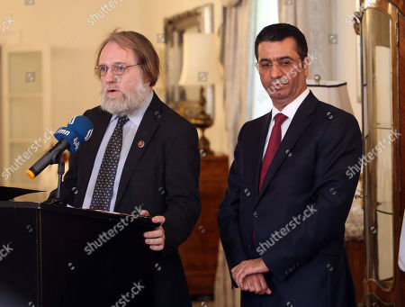 Stock Photo of St John Simpson, Assistant Keeper of the Department of the Middle East in the British Museum, and Dr Saleh Altamimi Ambassador of Iraq in London, are pictured at a ceremony at the Iraq Ambassadors' residence in London to commerate the returning of 154 Mesopotamian texts written on clay in cuneiform scripts to Iraq in London, August 29th 2019.   The tablets are being handed back to the Iraq Museum on behalf of the British Museum at at ceremony. They range in date from the mid-third millennium BC to the Achaemenid period (sixth-fourth centuries BC). The earliest are Early Dynastic administrative tablets and the latest are dated to the reigns of one Darius and one Artaxerxes but most date to the period between 2100 and 1800 BC and belong to the Ur III and Old Babylonian dynasties. Some carry cylinder seal impressions and some are still enclosed in their clay envelopes. The texts include letters and a mathematical text but most are economic texts and many belong to a single administrative archive coming from a place called Irisagrig. This city was unknown until tablets referring to it surfaced on the art market in 2003 when the site - like many others in southern Iraq - must have been heavily looted in the immediate aftermath of the American-led invasion of Iraq and the overthrow of the Saddam-led government. The tablets will be returned to the Iraq Museum which is part of the State Board of Antiquities and Heritage of Iraq.