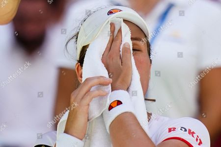 Johanna Konta of Great Britain reacts on her chair following her defeat in the quarterfinal in the Arthur Ashe Stadium
