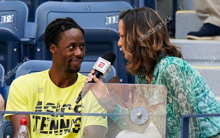 Pam Shriver interviews Gael Monfils of France in the player's box for ESPN ahead of the quarterfinal between Elina Svitolina of Ukraine and Johanna Konta of Great Britain