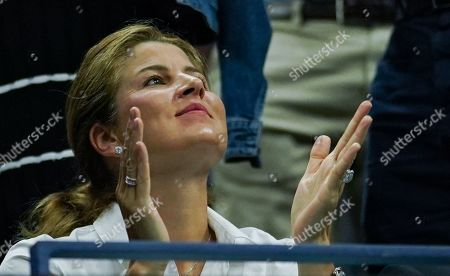 Mirka Federer reacts in the player's box as she watches Roger Federer of Switzerland play in the quarterfinal in the Arthur Ashe Stadium